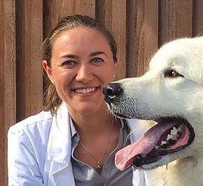 Dr Jessica Aulisio with a white dog